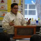 Adrian teaching young students about bees